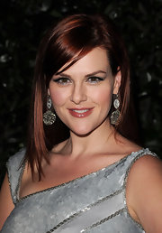 Actress Sara Rue coupled her silver embellished gown with decorative silver earrings.