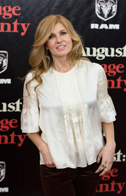 Connie Britton was casual and girly at the 'August: Osage County' premiere in an ivory silk blouse with trumpet sleeves and pleated detailing.