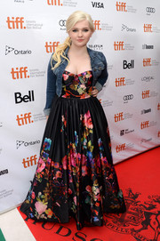Abigail Breslin showed her quirky style with this floral gown and denim jacket combo at the premiere of 'August: Osage County.'