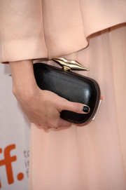 Jennifer Morrison accessorized with a black hard-case clutch featuring lip-shaped hardware when she attended the 'August: Osage County' premiere.