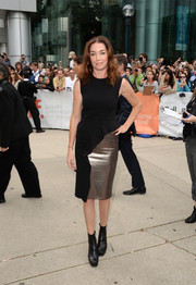 Julianne Nicholson completed her outfit with a pair of black mid-calf boots.