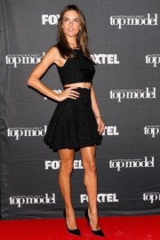 Alessandra Ambrosio flaunted some fab abs in a sleeveless black Alex Perry crop-top while visiting the 'Australia's Next Top Model' set.