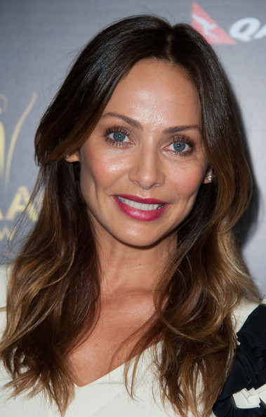 Bright red lipstick provided a pretty pop of color to Natalie Imbruglia's look during the AACTA International Awards.