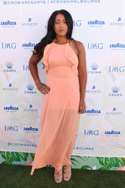 Naomi Osaka looked lovely in a peach halter maxi dress with ruffle detailing at the 2017 Australian Open party.