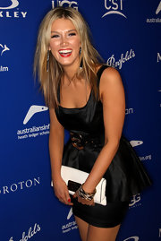 Delta Goodrem matched a white leather clutch with her peplum LBD at the 2010 Breakthrough Awards.