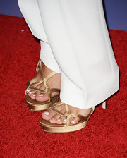 Claire Holt showed off her perfectly pedicured toes with these gold strappy sandals.