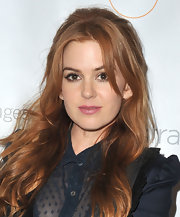Isla Fisher's lovely red tresses cascading into lovely waves when styled into a half up, half down 'do.