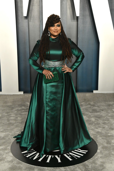 Ava DuVernay Beaded Clutch [clothing,green,dress,formal wear,fashion model,gown,fashion,lady,fashion design,outerwear,radhika jones - arrivals,radhika jones,ava duvernay,beverly hills,california,wallis annenberg center for the performing arts,oscar party,vanity fair,ava duvernay,wallis annenberg center for the performing arts,oscar party,vanity fair,academy awards,celebrity,party,fashion,dress]