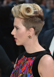 Scarlett Johansson matched her colorful outfit with a beautiful pair of multi-gem studs.