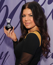 At the launch of Outspoke, Fergie showed off her gold knuckle ring.