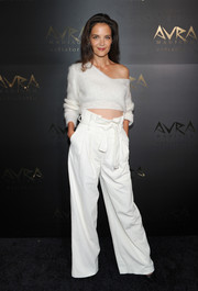 Katie Holmes showcased her abs and shoulder in a cropped white boatneck sweater by H&M Studio at the Avra Madison grand opening.