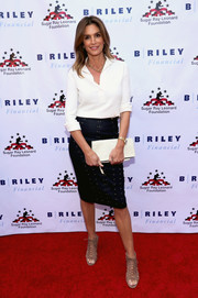 Cindy Crawford jazzed up her plain top with a studded navy pencil skirt.