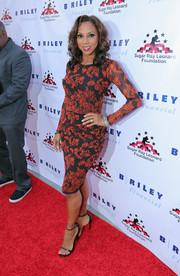 Holly Robinson Peete showed off her figure in a fitted red and black floral dress during the Big Fighters, Big Cause charity event.