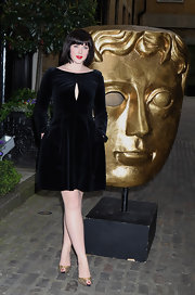 Alexandra Roach chose this blue velvet dress with a cutout detail on the bust for her look at the BAFTA Craft Awards.