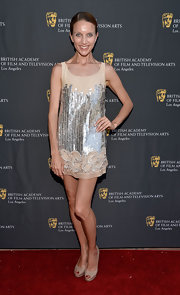 Summer Watson glittered in a nude mini dress with metallic embellishments at the BAFTA LA garden party.