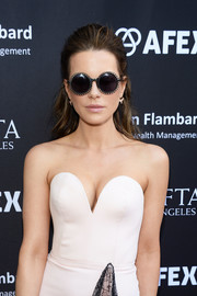 Kate Beckinsale looked adorable wearing these petal-trimmed round sunglasses by Preen at the BAFTA LA garden party.