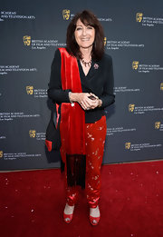 Katy Haber teamed embroidered red silk pants with a structured top and a fringed scarf for her BAFTA LA garden party look.
