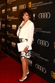 Joan Collins looked flawless in a white cropped jacket layered over a print dress at the BAFTA LA TV Tea.