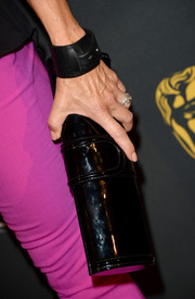 Lisa Rinna chose a black patent leather clutch to complete her outfit at the BAFTA LA TV Tea.
