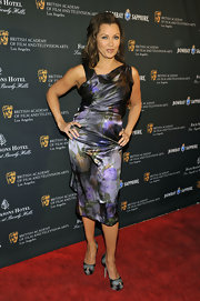 Vanessa struck a pose at the BAFTA Awards in an iridescent cocktail dress with a subtle garden print.