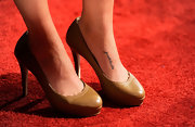Claire Holt kept her shoes rather simple with a pair of mustard round-toe pumps.