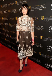 Lena Headey wore a girly black-and-white cocktail dress featuring a sheer bodice and lovely floral appliques and embroidery to the BAFTA Tea Party.