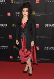 Helena Bonham Carter channeled her Gothic side at the BAFTA Britannia Awards in a maroon draped dress and black coat.