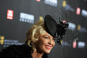 Amanda Eliasch made a theatrical statement with a black head fascinator featured a floral piece and a large veil.