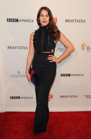 Lola Kirke looked glam in a figure-hugging black sheer top and high-waisted pants.