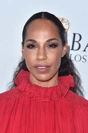 Amanda Brugel sported a curly ponytail at the BAFTA Los Angeles + BBC America TV Tea Party.