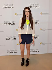 Isabelle Fuhrman chose a pair of navy short shorts with neon trim to bring out the neon in her statement necklace.