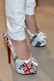 Summer Watson's platform pumps featured images of the Union Jack and British newspapers. Super cool!