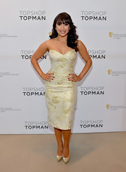 Cheryl Burke showed off some shoulder when she rocked a golden strapless dress at a BAFTA event in LA.