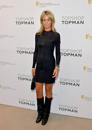 Lady Victoria Hervey chose this long-sleeve, LBD with leather paneling for a monochromatic look.