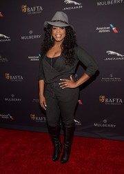 Niecy Nash teamed her jumpsuit with black knee-high boots for a funkier finish.