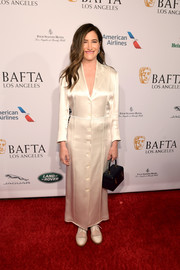 Kathryn Hahn donned a white maxi tux dress for the BAFTA Los Angeles Tea Party.