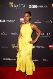 Issa Rae brightened up the red carpet with this canary-yellow mermaid gown by Rosie Assoulin at the BAFTA Los Angeles Tea Party.