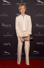 Rene Russo donned a classic white silk blouse for a relaxed yet sophisticated look during the BAFTA Los Angeles tea party.