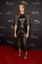 Cara Delevingne was tough-chic in a black mesh-panel leather LBD by Mulberry at the BAFTA Los Angeles tea party.