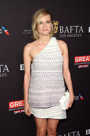 Diane Kruger teamed a white Edie Parker box clutch with a one-shoulder look for the BAFTA Los Angeles Tea Party.