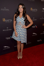 Gina Rodriguez completed her outfit with nude cutout pumps by Stuart Weitzman.
