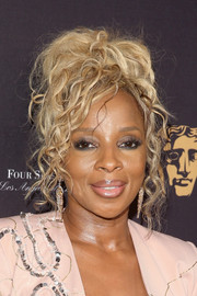 Mary J. Blige sported a rocker-glam updo at the BAFTA Los Angeles Tea Party.