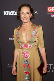 Laurie Metcalf accessorized with a chic burgundy envelope clutch at the BAFTA Los Angeles Tea Party.