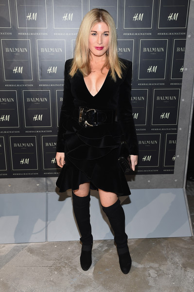 Hofit Golan looked flirty in a low-cut LBD with a ruffle skirt at the Balmain x H&M collection launch.