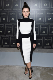Eve Hewson was monochrome-chic in a Balmain x H&M turtleneck dress during the collaboration's launch.