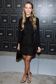 Harley Viera-Newton attended the Balmain x H&M launch wearing a sleeveless rope-detail LBD from the collection. She put her own spin on the design by layering it over a collared shirt.
