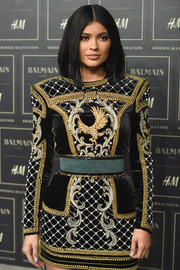 Kylie Jenner flaunted her tiny waist with an oversized green belt by Balmain x H&M when she attended the collaboration's launch.