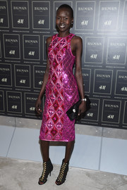 Alek Wek couldn't be missed in a quilted metallic-pink pencil dress by Balmain x H&M during the collaboration's launch.