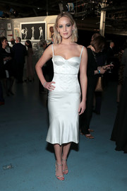 For her shoes, Jennifer Lawrence chose a pair of silver slim-strap sandals by Jimmy Choo.