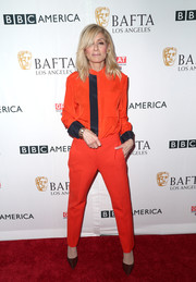 Judith Light matched her shirt with a pair of orange slacks.